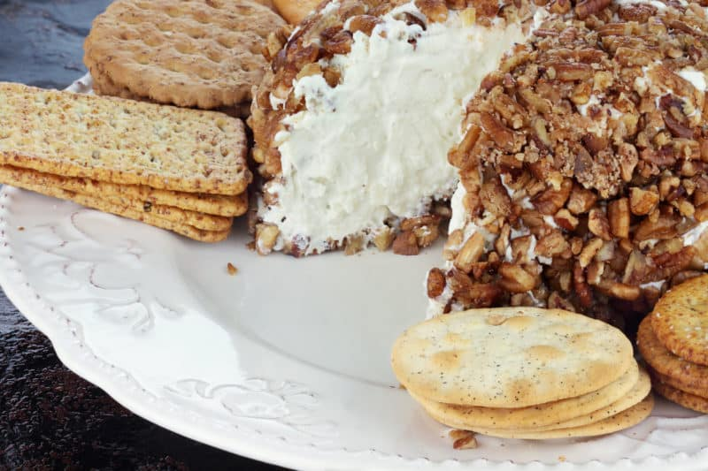 Cheese Ball rolled in pecans with crackers