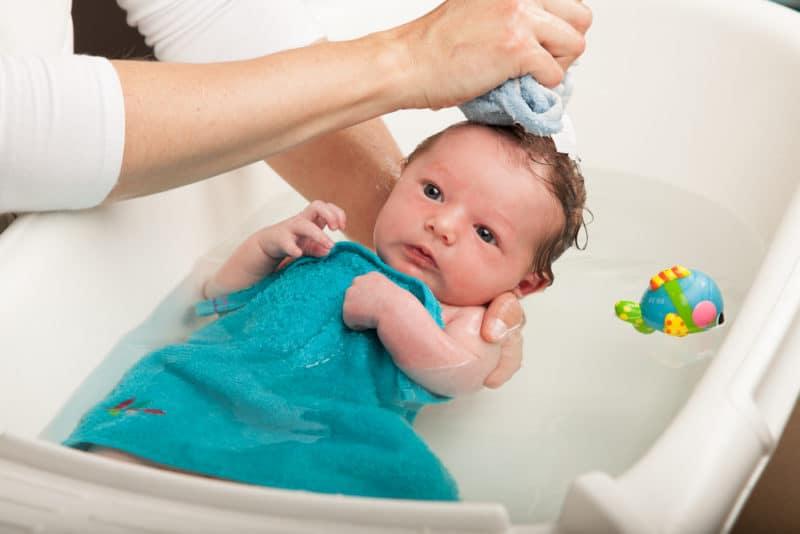 newborn baby in baby bath