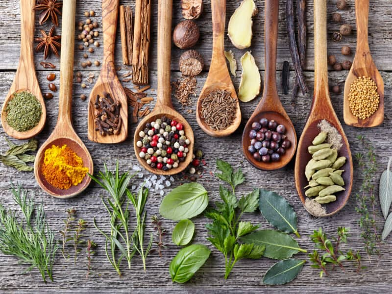 Five-Spiced Turkey uses a blend of spices and herbs, like these wooden spoonfuls