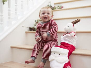 Toddler on stairs with Christmas stocking